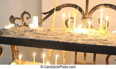 Candles burning in Catholic Church