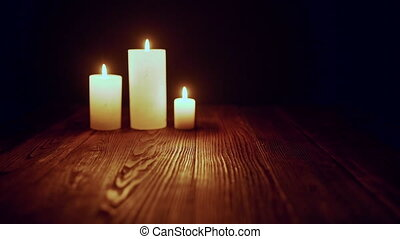 Candles burning in dark - Three candles burning in dark...