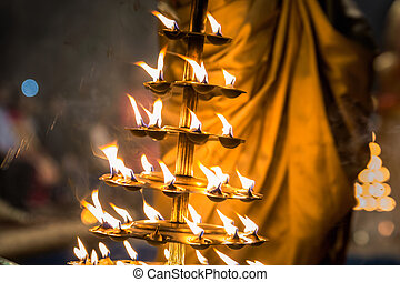 Candles fire puja - Candles used in performance of religious...