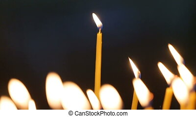 Candles flaming in candlestick - Happy young woman blows out...