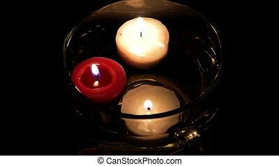 Candles floating in a glass bowl