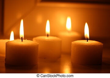 Candles - Holiday candles burning on a white background and...
