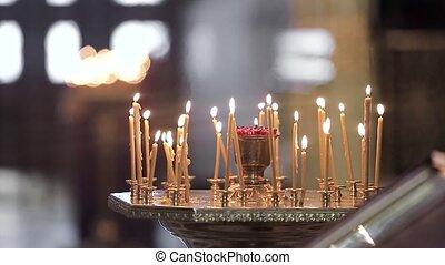 Candles in a church. Lighrs HD