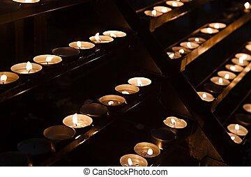 Candles in a dark church