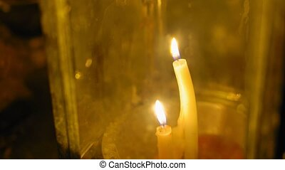 candles in a traditional Asian lantern, a religious place of worship. Buddhism.