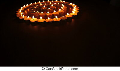 Candles in Concentric Circles Dolly - Dolly shot of many...