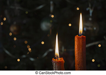 Candles in front of the Christmas tree