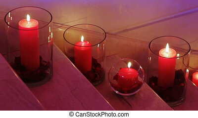 Candles in glass flasks