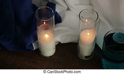 Candles in glass on the floor