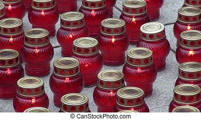 Candles in red glass lanterns for funeral - Candles in red...