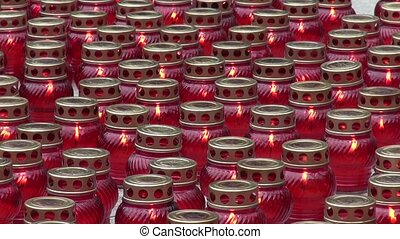 Candles in red glass lanterns funeral or religious or...