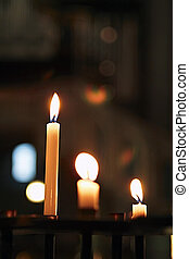 Candles in the church - candles glowing in the church.