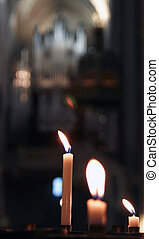 Candles in the church. - candles glowing in the church.