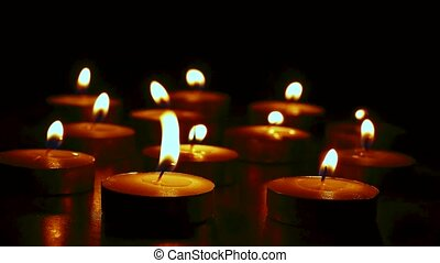 Candles in the dark with soft focus and bokeh. Memorial...