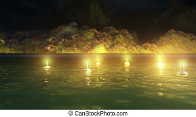 candles in the river at night