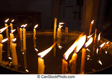 Candles light in the holy sepulchre cathedral in Jerusalem