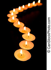 Candles lighting in a curved line