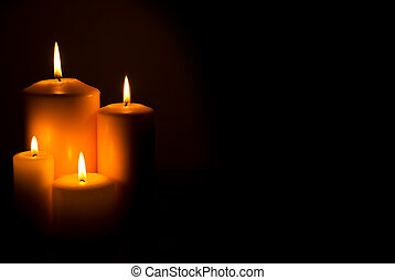 Candles lights - Group of four candles lights in a side in...
