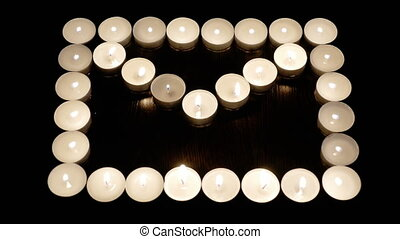 Candles lined up in a row. Lights up one after drugoy.