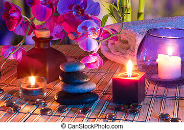 candles, oil, potpourri, stones, glass dots, orchids and bamboo