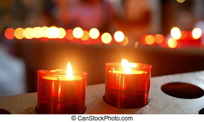 Candles old church people - Unidentified people lit of...