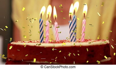 Candles on a birthday cake and confetti