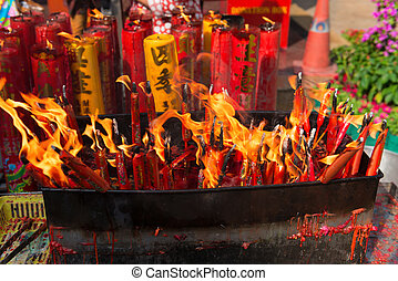 Candles on a Buddhist Altar for the Chinese New Year -...