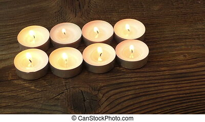 Candles on a wood background