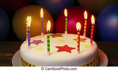 Candles On Birthday Cake With Colorful Balloons - Candles on...