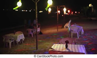 Candles on outdoor restaurant table tropical beach. Romantic setting for anniversary or honeymoon. 1920x1080