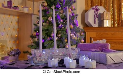 candles on the background of a Christmas tree - in the...