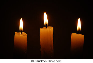 candles - three candles over black background