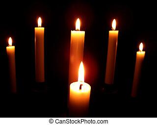 portrait of six beautiful burning candles on black background