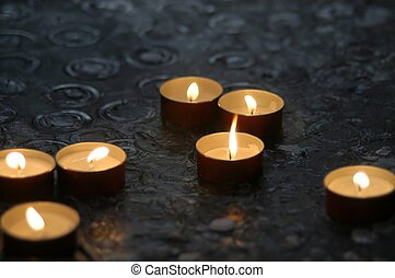 Candles, randomly spaced. Taken in a church.