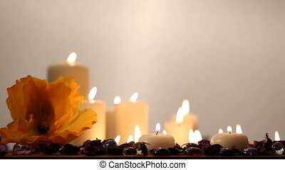 Medium shot of candles against the white backgroung. Blank space avaliable.