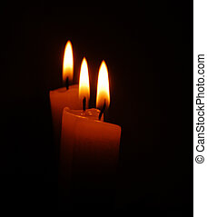 candles over black background