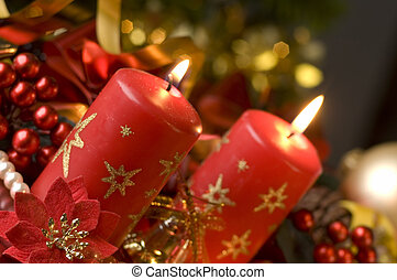 candles in front of decorated background close up