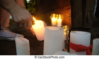 Candles. The hand lights the candles