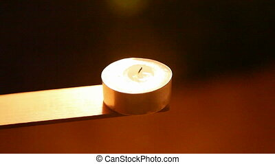 candles  - Tea lights are lit in the night