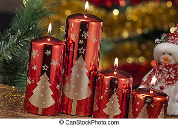 candles with christmas decorations in atmospheric light -...
