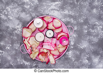 candles with rose petals on pink tray, cosmetics and gift...