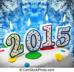 candles with the symbol of the new year 2015 on the cake -...
