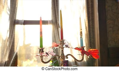 Candlestick with candles - silver candlestick on a...