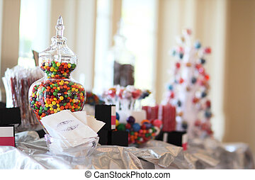 Candy Bar - Different types of candy and bags on a table