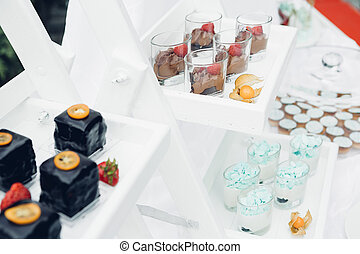Candy bar on nature. Delicious cakes