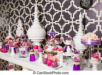 Candy bar. Table with sweets on the wedding day