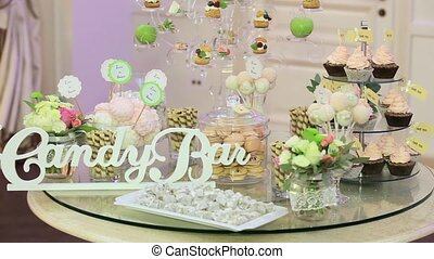 Candy bar with cookies and colorful candy on plate for birthday, anniversary, wedding
