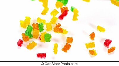 Candy bears falling against White Background, Slow Motion