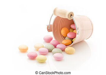 Candy. - Candy colored small bucket isolated on a white ...