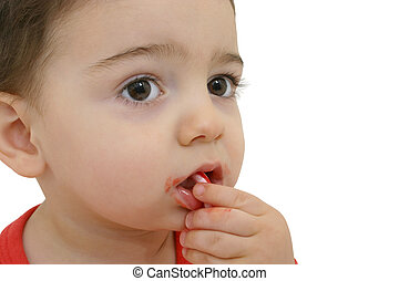 Candy Cane Boy - Toddler boy in red long-johns eating a...
